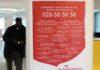 """Плакат в здании администрации шведской коммуны Нака призывает звонить на телефон """"горячей линии"""" в случаях сексуального насилия. Фото: Валерий Поташов"""